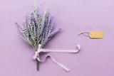 Lavender flower on purple wooden background.