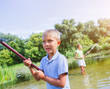 Lonely little child fishing on river