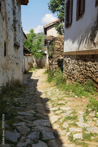 Papiers peints Ruelle etroite Stone walls and narrow street