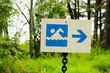 A blue beach beach sign with a direction arrow