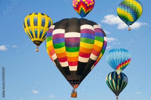 Deurstickers Ballon Hot air balloons up in the blue sky