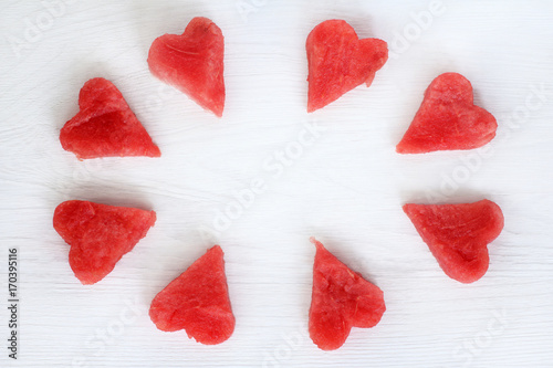 sweet frame for lovers/ eight slices of a ripe watermelon in the shape of hearts on a table top view