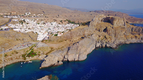 Fotobehang Nachtblauw Aerial drone photo of famous beach of Lindos with turquoise waters and iconic ancient Acropolis - village of Lindos, Rodos island, Aegean, Dodecanese, Greece