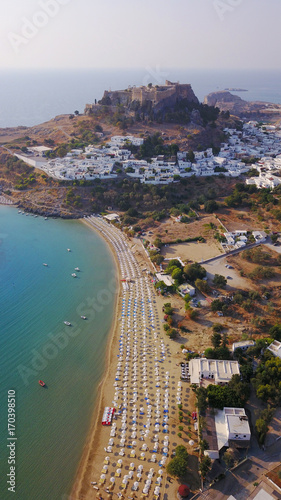 Fotobehang Nice Aerial drone photo of famous beach of Lindos with turquoise waters and iconic ancient Acropolis - village of Lindos, Rodos island, Aegean, Dodecanese, Greece