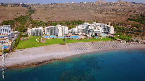 Fotobehang Caraïben August 2017: Aerial drone photo of famous Kalithea beach seascape with clear waters and 5 star resorts, Faliraki bay, Rodos island, Aegean, Dodecanese, Greece