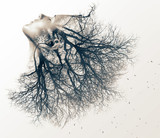 Double exposure portrait of young woman and tree.