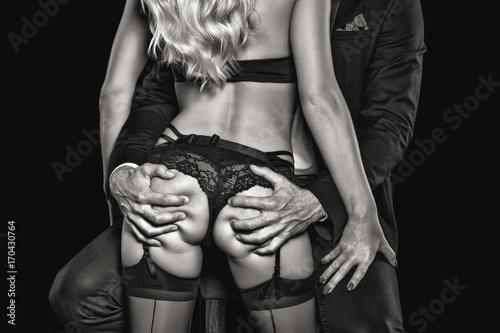 Leinwanddruck Bild Rich man grab sexy blonde lover ass black and white