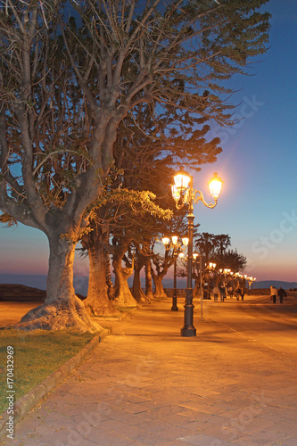 Fotobehang Stenen Promenade at night, Sardinia