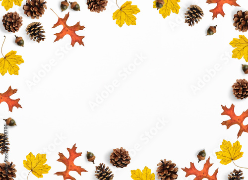 Fotobehang Herfst Autumn mockup scene. Creative fall composition made of colorful maple, oak leaves, pine cones and acorns, flat lay. Isolated natural objects on the white background.Space for your text, top view.