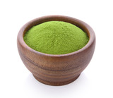 green tea powder in wood bowl on white background