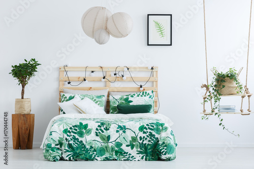 Bed with floral overlay