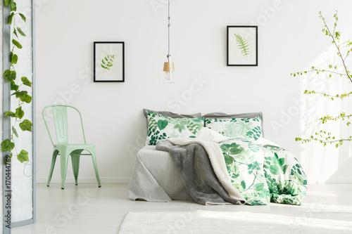 Mint chair in inspiring bedroom - 170444769