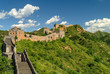 Great Wall of China winding its way over the mountains with beautiful sky