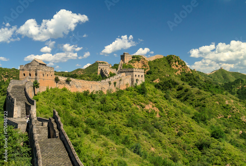 Foto op Canvas Peking Great Wall of China winding its way over the mountains with beautiful sky