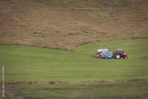 Tractor with plowes on an Iceland field Poster