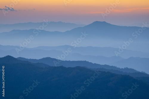 Papiers peints Bleu nuit Landscape hill scene while sunset.