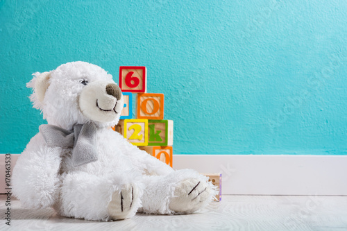 Teddy bear in a baby's room