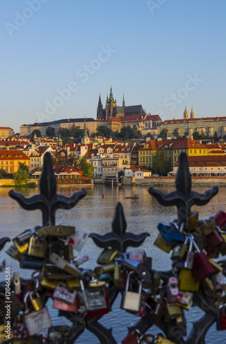 Fotobehang Praag Prague and Vltava river. In front metal fence with attached padlocks