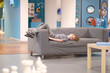 The boy is lying on the sofa in the children's center of entertaining science