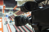 Professional camera with microphone at basketball game in modern stadium - 170502545