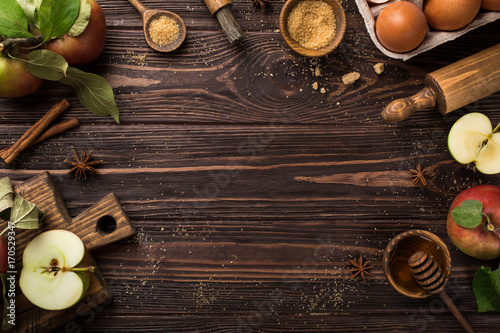 Wooden background with ingredients for baking apple pie