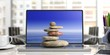 Zen stones stack on a computer, office background. 3d illustration