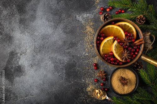 Fototapeta Christmas food background , mulled wine and ingredients on dark grey concrete surface