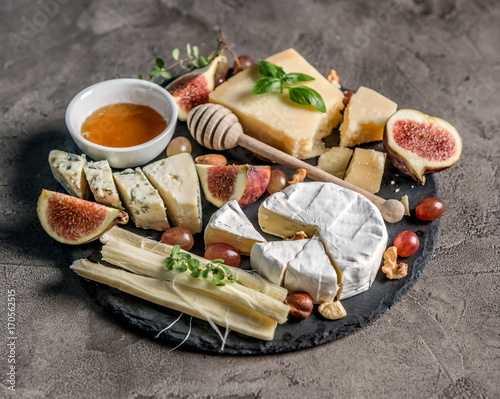 Cheese plate served with wine, nuts and honey  - 170562515