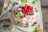 Sweet and creamy Pavlova cake with berries and meringue