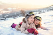 Happy and cheerful girls spend time outside on a  winter day