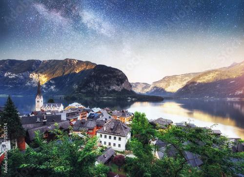 Foto op Plexiglas Amsterdam Scenic panoramic view of the famous mountain village in the Austrian Alps. Fantastic milky way. Hallstatt. Austria