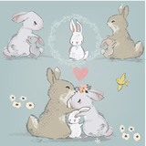cute hares couple with children