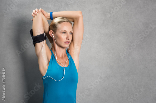 Wall mural Sporty woman exercising