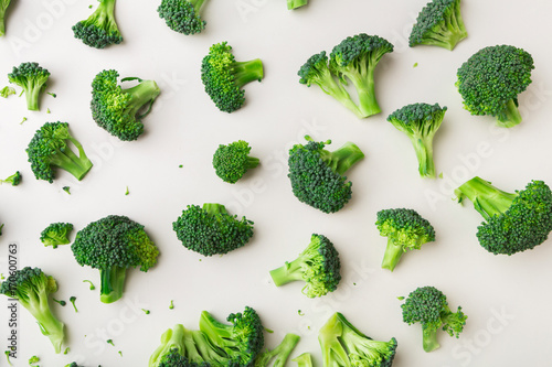 Pattern with broccoli on white background.