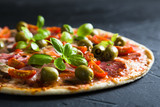Pizza on a thin dough with olives and fresh basil - 170610727