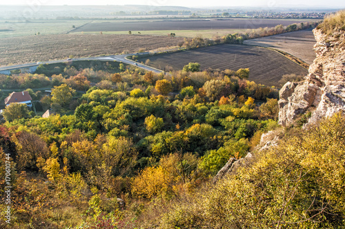 Papiers peints Automne Seasonal natural outdoors scene – rocks, colorful trees, village, road and fields