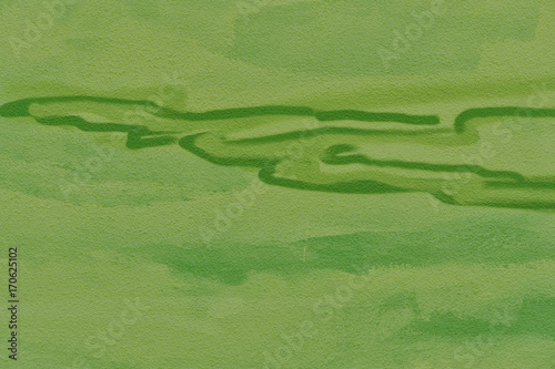 Abstract green background. Detail of a graffiti art on a wall. Texture of painted wall.