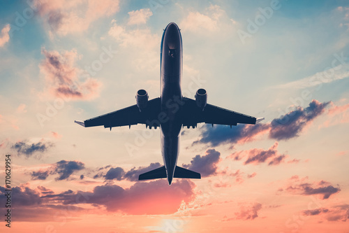 airplane on sunset sky  - jet, flying airplane Poster