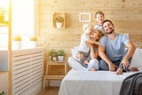 Fototapety  happy family mother father and children daughter and son in bed