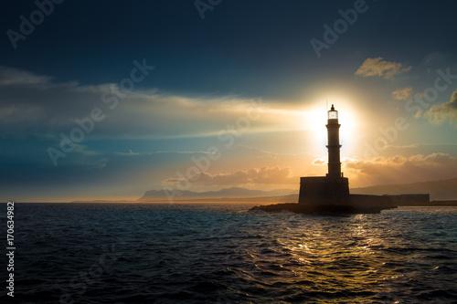 Fotobehang Vuurtoren Lighthouse on sunset. Chania, Crete, Greece.