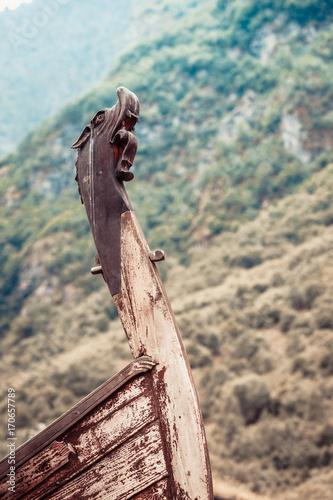 Fotobehang Schip Part of old wooden viking boat in norwegian nature