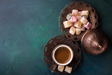 Traditional turkish coffee  and turkish delight on dark green wooden background. flat lay - 170683994