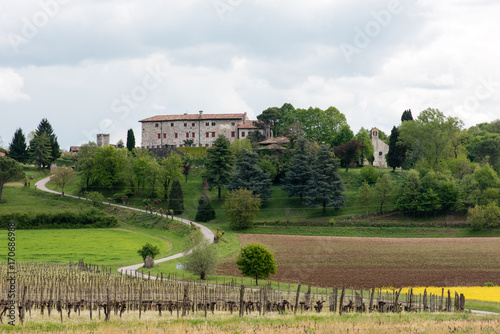 Fotobehang Diepbruine Castles and ancient churches on the Friuli hills. Journey to Arcano. Udine