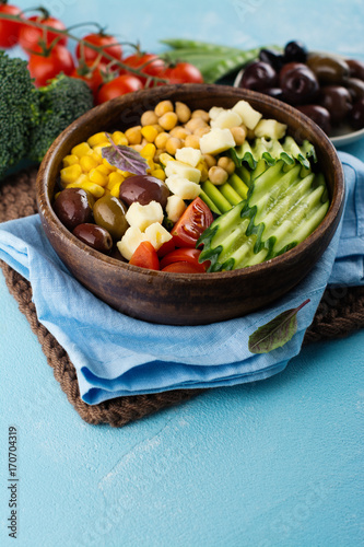 Foto op Canvas Boeddha Raw food diet or clean eating concept. Fresh summer vegetarian meal. Space for text