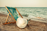 Beach Chair. hat and sea view. The concept of rest