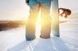 Closeup snowboarder at ski slope with snowboard