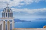 white  and blue belfries against volcano caldera, beautiful details of Santorini island, Greece - 170725536