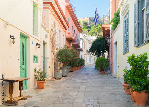Fototapeta small paved street of Placa district with Acropolis hill in Athens, Greece