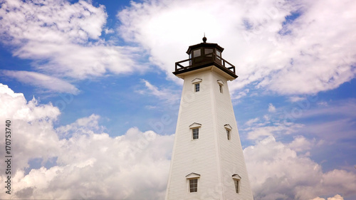 Fotobehang Vuurtoren Lighthouse Against Cloud Filled Sky in Gulfport, Mississippi