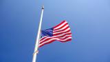 American Flag at Half Mast aka Half Staff Against Clear Blue Sky - 170753987